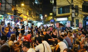 Daring locals at Bia Hoi Junction for a drinking competition