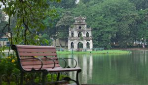 Sit on a bench at Hoan Kiem Lake